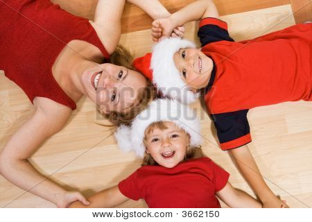Family On The Floor At Christmas