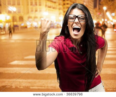 young successful young girl against a city night background