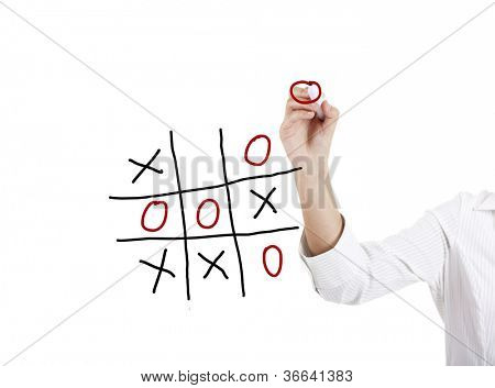 Young businesswoman playing the game noughts and crosses