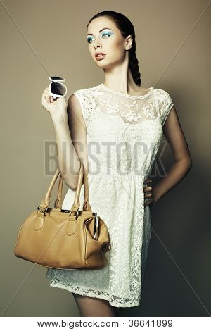 Portrait Of Beautiful Young Woman With A Leather Bag