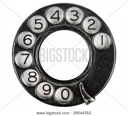 Close up of Vintage phone dial on white