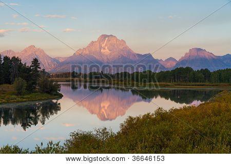 Reflection Of Grand Teton Range At Sunrise