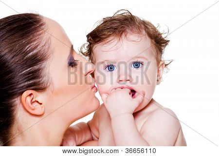 Mother kissing her angelic baby -closeup portrait
