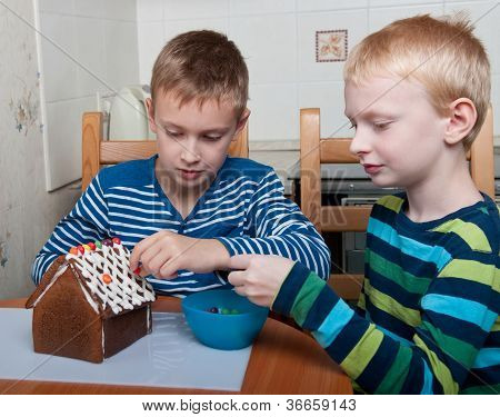 Two Boys Making Gingerbread House