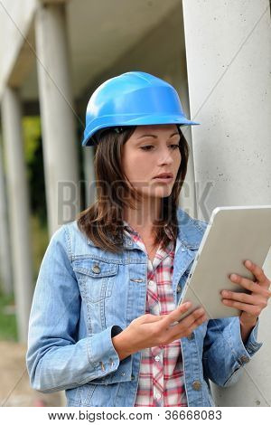 Architect on building site working with electronic tablet