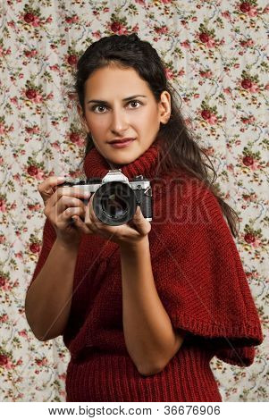 Woman In Red Over Floral Background
