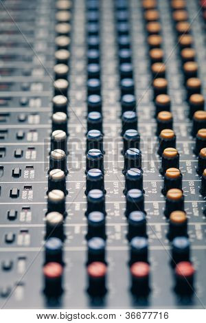 studio mixer knobs and faders