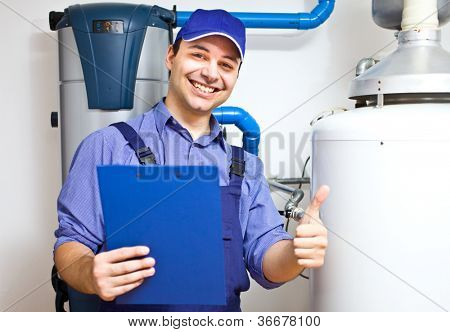 Smiling technician servicing an hot-water heater