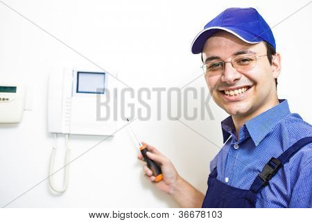 Portrait of a smiling technician at work