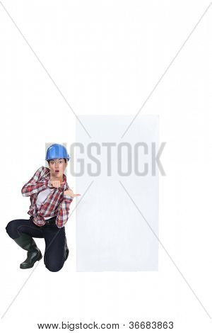 A female construction worker promoting.