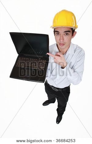 Engineer pointing to a laptop
