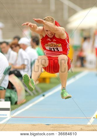 BARCELONA - JULY 10: Benjamin Gfohler of Switzerland during Long Jump Decathlon event of the 20th World Junior Athletics Championships at the Olympic Stadium on July 10, 2012 in Barcelona, Spain