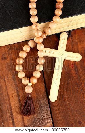 the Wooden rosary beads and holy bible close-up