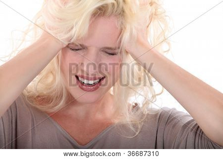 Blond woman suffering from headache