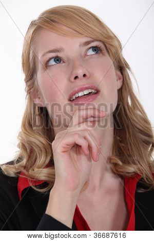 woman wondering and holding her chin