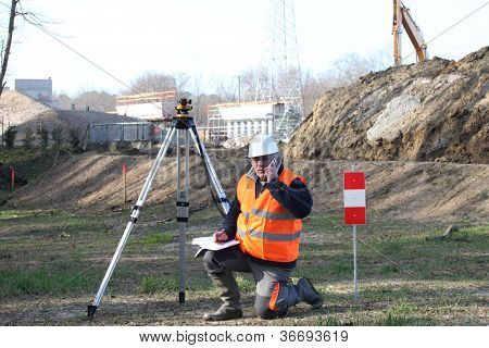 Surveyor setting up his specialized equipment
