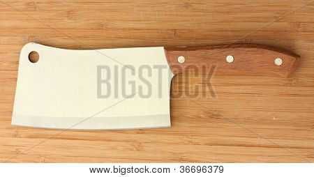 meat cleaver on wooden background close-up