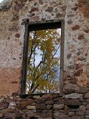 picture of fieldstone-wall  - second story farmhouse doorway looking through the ruins to the trees and sky beyond - JPG