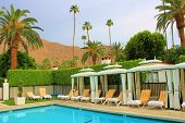 stock photo of cabana  - Luxury pool with cabanas in Palm Springs - JPG