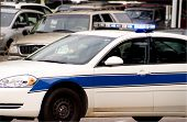 stock photo of lightbar  - A police car out protecting and serving the public - JPG