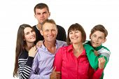 Happy big caucasian family having fun and smiling over white background. Mother, father and children