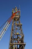 picture of derrick  - Crane in front of a derrick on an offshore drilling platform - JPG