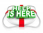 A white life preserver with the words Help is Here announcing that support and assistance is availab