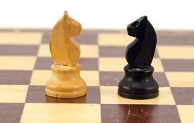 stock photo of cobnuts  - Gold crocodile crush tool with nut in maw on chess board and cobnuts stan like checkers concept - JPG