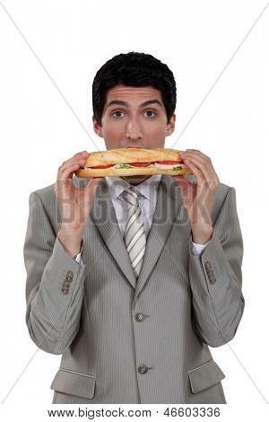 Businessman eating a yummy sandwich