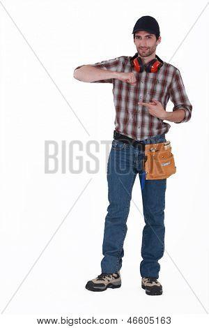 full-body portrait of handsome carpenter wearing cap