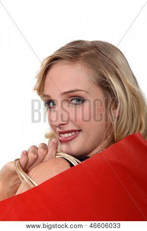 close-up portrait of ravishing blonde holding shopping bags
