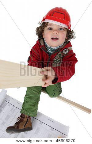 Little boy pretending to be a carpenter