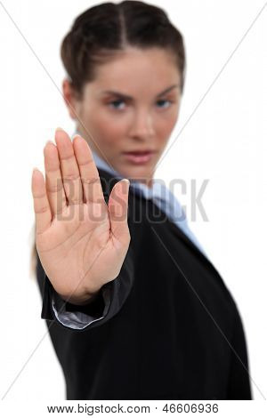 Businesswoman making stop gesture
