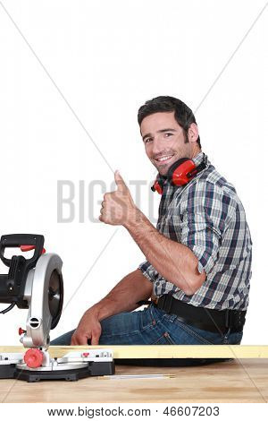Approving tradesman using a mitre saw