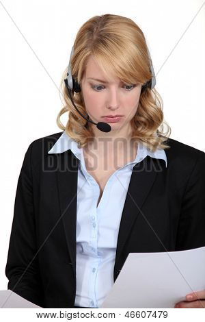 call center employee reading documents and looking confused