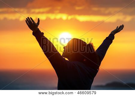 Woman Praising And Enjoying Golden Sunset