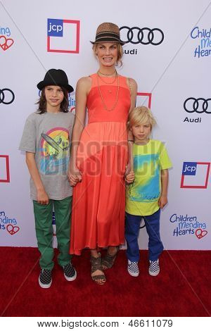 LOS ANGELES - JUN 8:  Angela Lindvall, with sons Sebastian Edwards, William Edwards arrives at the 1st Annual Children Mending Hearts at the Private Residence on June 8, 2013 in Beverly Hills, CA
