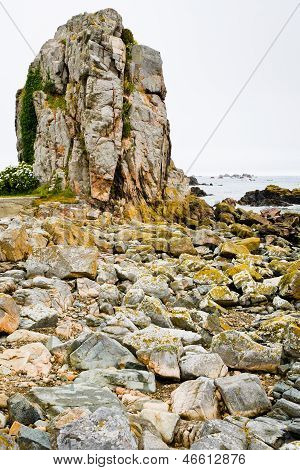 Old Granite Rock On Coast Of La Manche