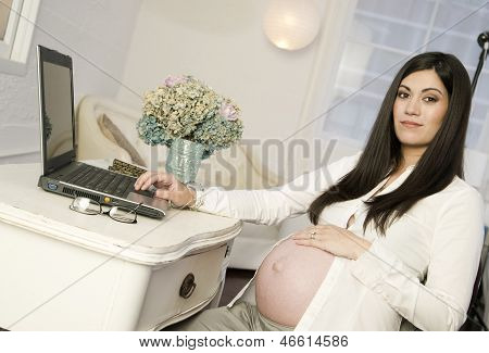 Beautiful Pregnant Woman Shows Belly Work Desk Working Laptop Computer