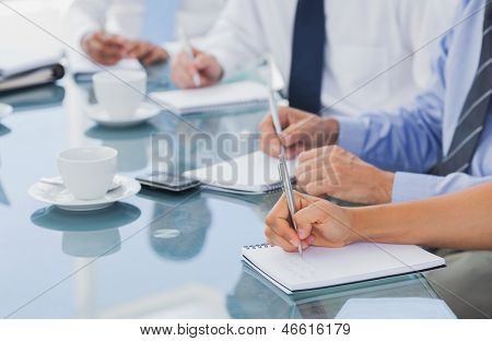 Business people hands taking some notes during a meeting