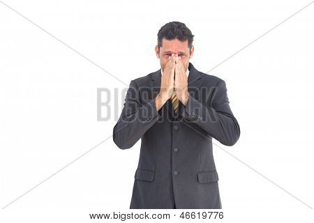 Apprehensive businessman looking at the camera on a white background