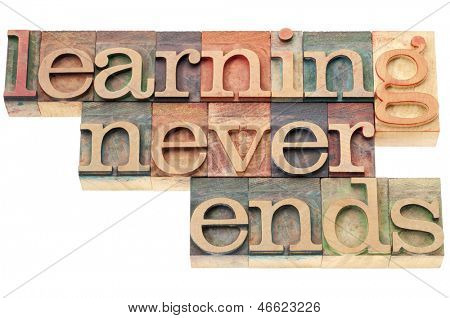 learning never ends - continuous education concept  - isolated text in letterpress wood type