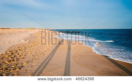 Long Evening Shadows On The Beach At Cape May, New Jersey.