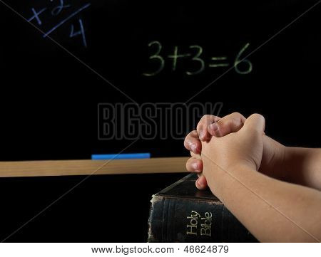 child praying in school