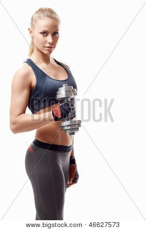 Sports girl with dumbbells on a white background