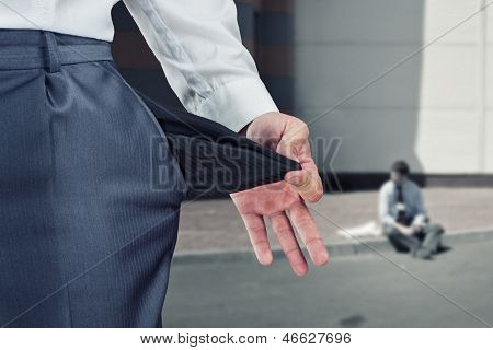 Businessman pulling empty pocket out of pants