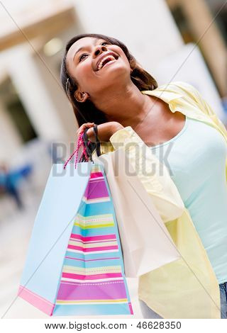 Very happy shopping woman at the mall