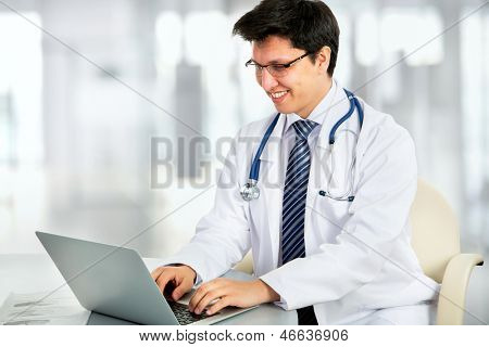 Medical doctor working with laptop in the hospital