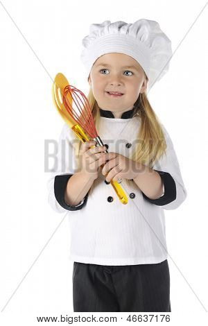 "An adorable preschool ""chef"" happily holding colorful utensils.  On a white background."
