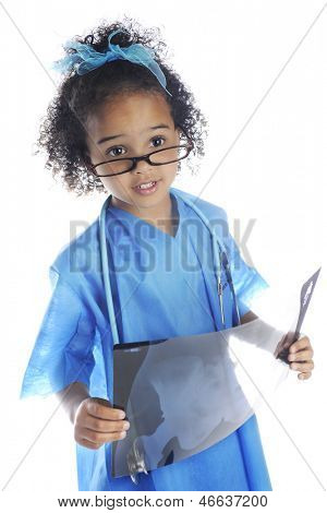 "An adorable preschool ""doctor"" peering over her glasses as she examines the x-ray she's holding.  On a white background."